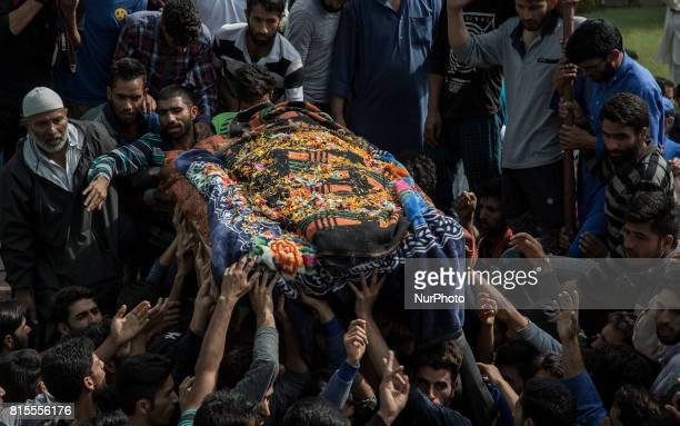 Kashmiri villagers carry the body of a local rebel Parvaiz Mir during his funeral procession Sunday July 16 in Pohoo village 38 kilometers south of...