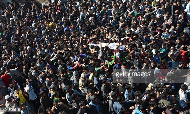 Kashmiri villagers carry the body of LashkarEToiba chief Abdul Rehman alias Abu Kasim during his funeral in Kulgam south of Srinagar on October 29...