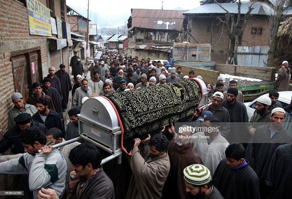 Kashmiri villagers carry the body of ruling National Conference Sarpanch Javaid Ahmad Wani in Kalantra village of north Kashmir's Baramulla district on February 25, 2013 in Srinagar, India. Unidentified gunmen shot dead the ruling National Conference Sarpanch outside his residence.