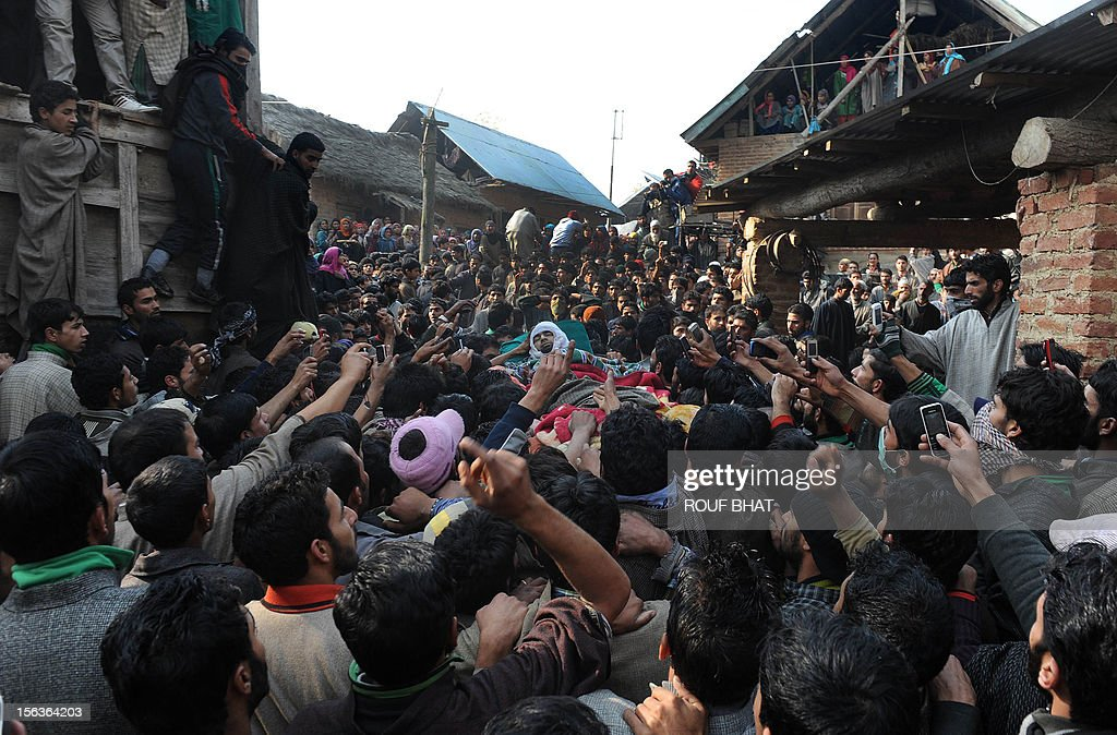 Kashmiri villagers carry the body of suspected militant of Lashkar-e-Taiba, Shabir Ahmad during his funeral procession in Chingam, some 61 kms south of Srinagar on November 14, 2012. Thousands of Muslim villagers attended the funeral of Ahmad, a suspected rebel who was killed in a gunbattle with Indian troops in the restive Kashmir. AFP PHOTO/Rouf BHAT