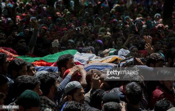 Kashmiri villagers carry the body of teenager Adil Magray during his funeral procession at Shopian about 60 kilometers south of Srinagar...
