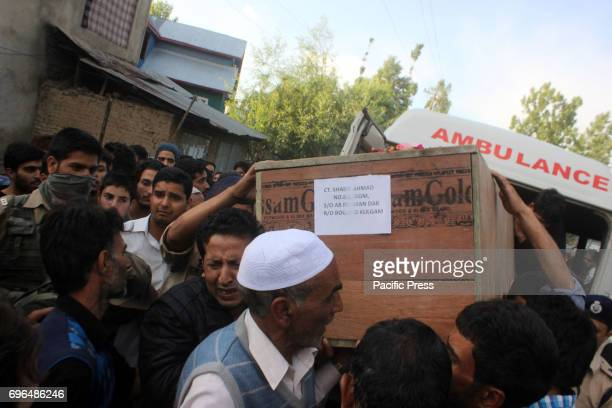 Kashmiri villagers carry the coffin of slain policeman Shabir Ah Dar killed by suspected militants on Thursday at village Bogund in Kulgam District