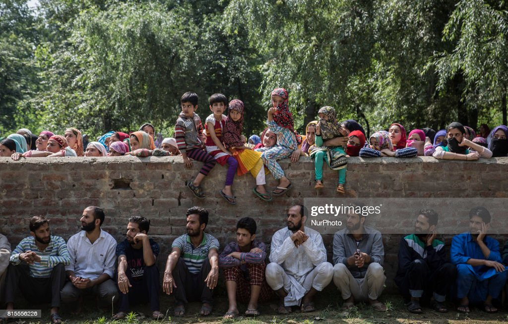 Kashmiri villagers including children watch the funeral procession of a local rebel Parvaiz Mir during his funeral, Sunday, July 16, 2017, in Pohoo village 38 kilometers (24 miles) south of Srinagar, Indian-administered Kashmir. Mir was killed along with two other rebels including a foreign national in a gunfight at a forest area in south Kashmirs Pulwama district on Saturday, police said.