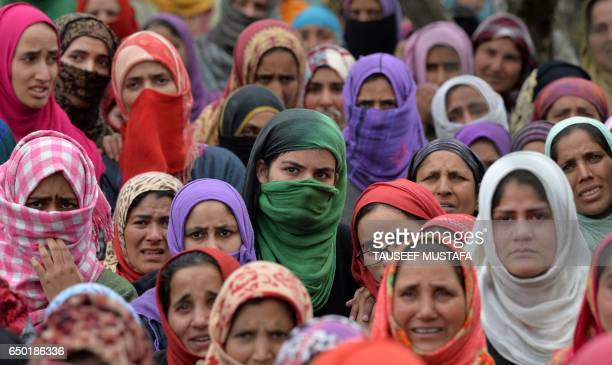 Kashmiri villagers mourn 15 year old Amir Nazir during his funeral in the village of Kakapora in Pulwama District some 30kms south of Srinagar on...