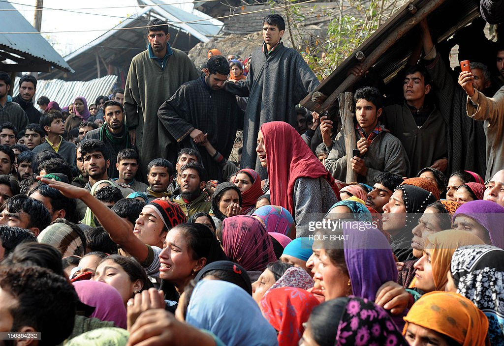 Kashmiri villagers mourn as the body of suspected militant of Lashkar-e-Taiba, Shabir Ahmad is carried during his funeral procession in Chingam, some 61 kms south of Srinagar on November 14, 2012. Thousands of Muslim villagers attended the funeral of Ahmad, a suspected rebel who was killed in a gunbattle with Indian troops in the restive Kashmir. AFP PHOTO/Rouf BHAT
