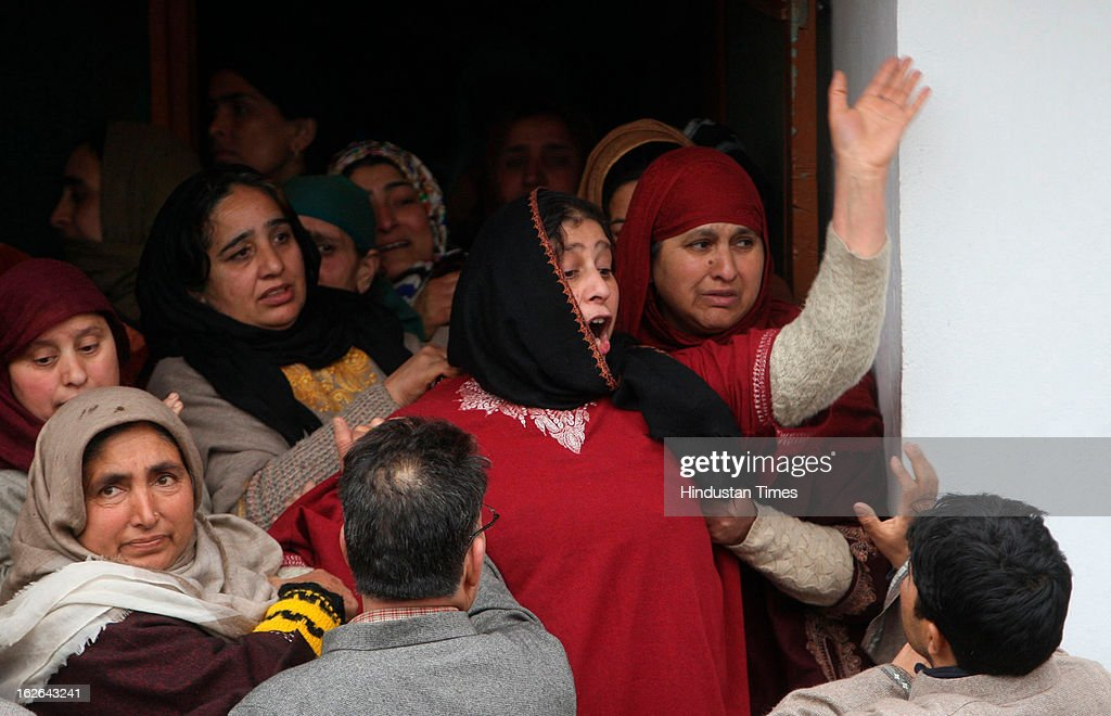 Kashmiri villagers mourn during the funeral of ruling National Conference Sarpanch Javaid Ahmad Wani in Kalantra village of north Kashmir's Baramulla district on February 25, 2013 in Srinagar, India. Unidentified gunmen shot dead the ruling National Conference Sarpanch outside his residence.