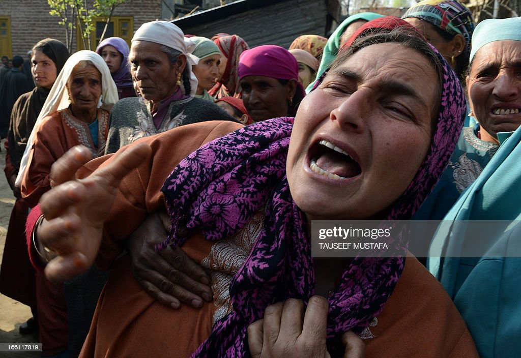 Kashmiri villagers mourn during the funeral of ruling National Conference sarpanch, Ghulam Mohammed Lone (45) in Kulpora village of south Kashmir's Pulwama district, some 45 kms from Srinagar on April 9,2013. Unidentified gunmen shot dead the ruling National Conference sarpanch outside his residence. Militants have targeted several panchayat - local self-government - members, killing six of them in the Valley since the panchayat elections were held in April 2011. AFP PHOTO/Tauseef MUSTAFA