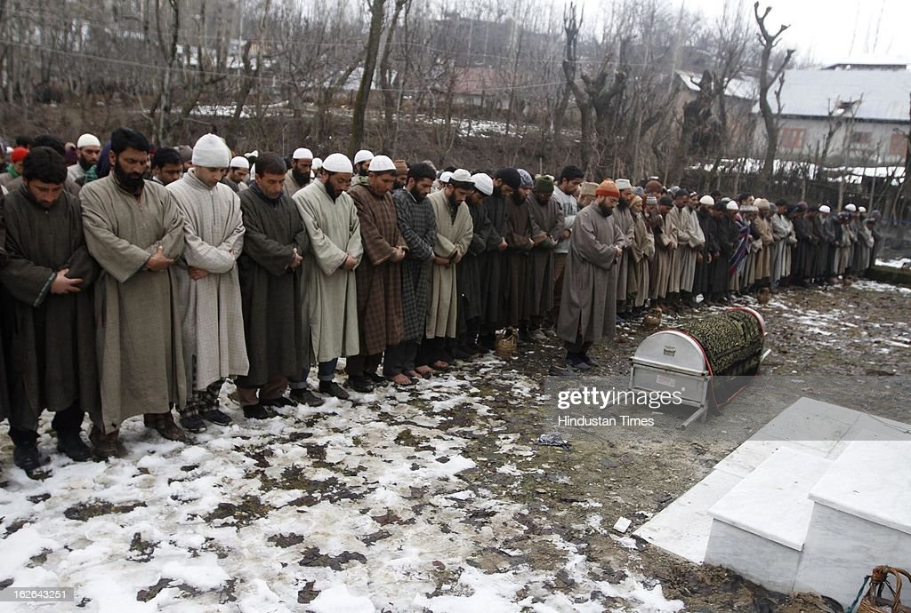 Kashmiri villagers offers funeral prayers during the funeral procession of ruling National Conference Sarpanch Javaid Ahmad Wani in Kalantra village of north Kashmir's Baramulla district on February 25, 2013 in Srinagar, India. Unidentified gunmen shot dead the ruling National Conference Sarpanch outside his residence.