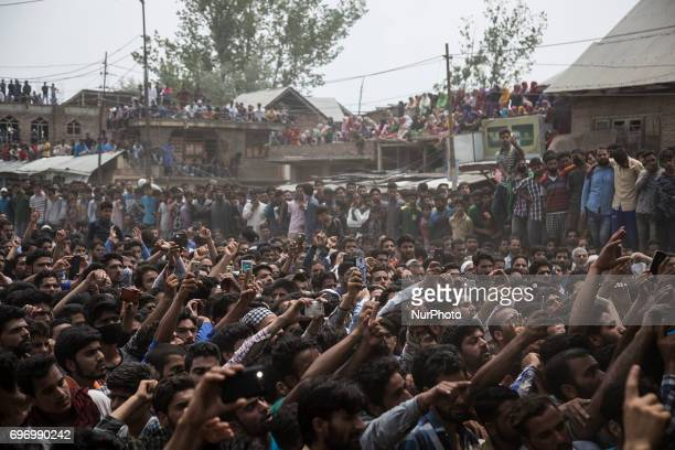 Kashmiri villagers raise profreedom slogans during the funeral procession of local rebel commander Junaid Matoo Saturday June 17 2017 in Khudwani...