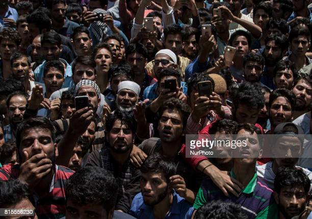 Kashmiri villagers react after looking at the body of a local rebel Parvaiz Mir during his funeral Sunday July 16 in Pohoo village 38 kilometers...
