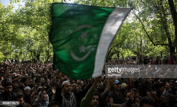 Kashmiri villagers shout profreedom slogans during the funeral of a teenager Adil Magray at Shopian about 60 kilometers south of Srinagar...