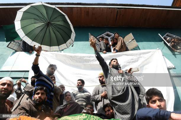 TOPSHOT Kashmiri villagers shout proindependence slogans at the funeral for rebel Tauseef Ahmed Wagay at Kanjkul village in Yaripora in south...