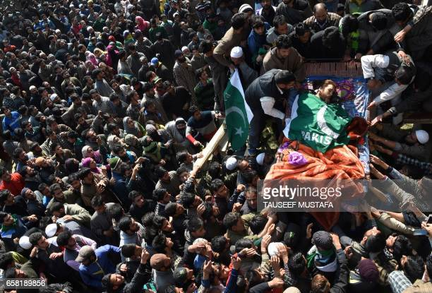 TOPSHOT Kashmiri villagers surround the body of suspected rebel Shahbaz Shafi also known as Rayees Kachroo at Belov village in Pulwama south of...