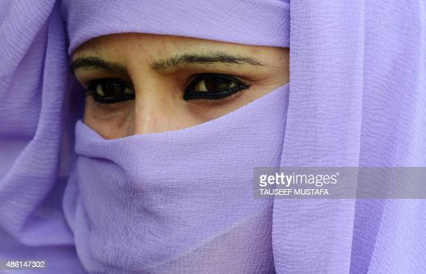 A Kashmiri volunteer from the National Youth Crops listens to a speech by the group's leader during a hunger strike in Srinagar on September 12015...