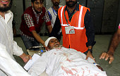 Kashmiri volunteers bring a man injured by pellets after being shot during clashes between security forces and protesters to hospital in the town of...