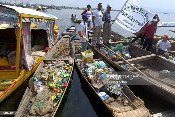 Kashmiri volunteers from a nongovernmental organisation collect rubbish during a drive to clean Dal Lake in Srinagar 24 June 2007 Raw sewage land...
