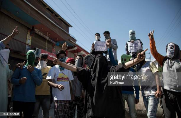 A Kashmiri woman along with masked protesters shout antiIndia amp profreedom slogans during a protest Friday June 9 in Srinagar Indianadministered...