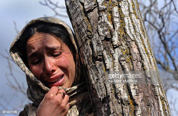 A Kashmiri woman cries at the funeral of Ghulam Mohammad one of four militants killed in a March 4 gun battle with security forces in Pastuna village...