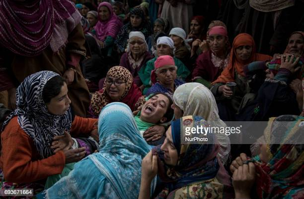 A Kashmiri woman cries during the funeral of a teenager Adil Magray at Shopian about 60 kilometers south of Srinagar Indianadministered Kashmir...