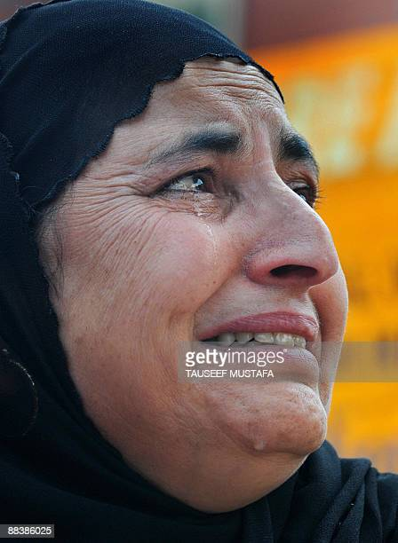A Kashmiri woman from the Association of Parents of Dissapeared people weeps during a demonstration in Srinagar on June 10 2009 Kashmir's leading...