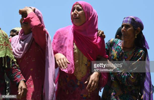 Kashmiri woman grieve during the funeral of slain rebel Abid Ahmed in the village of Hajin in the district Bandipora north of Srinagar on August 5...