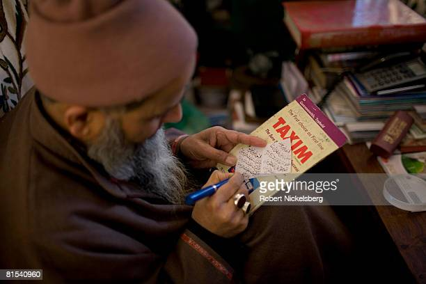 Kashmiri woman Hameeda Nazir 32 years claiming she suffers from anxiety and high blood pressure meets with a faith healer or peer Mohammed Altaf...