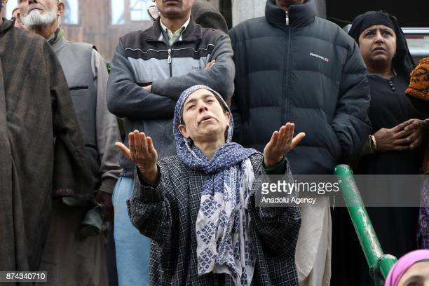 Kashmiri woman prays as she stares at the damaged 300 year old mosque of Mir Syed Ali Hamadani after a lightning hit in old Srinagar the summer...