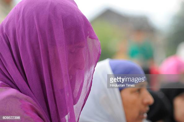 Kashmiri woman prays at the Hazratbal Shrine on September 21 2016 in Srinagar India People are holding special prayers to observe the Martyrs' Day of...
