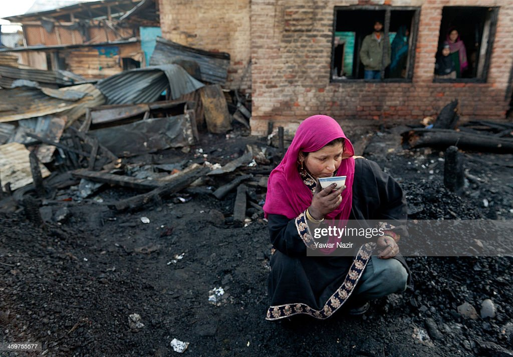 A Kashmiri woman rests on the debris of her house after a fire gutted many residential houses on December 30, 2012, in Srinagar, the summer capital of Indian administered Kashmir, India. Many families were left homeless amid sub-zero temperatures during the harshest 40-day period (Chilay Kalan) of the winter, after at least 30 residential houses were damaged in a devastating fire on the bank of famous Dal Lake near the Hazratbal shrine, in the outskirts of the Srinagar. The incident engulfed the area during the preceding night, an official said. No injuries were reported.
