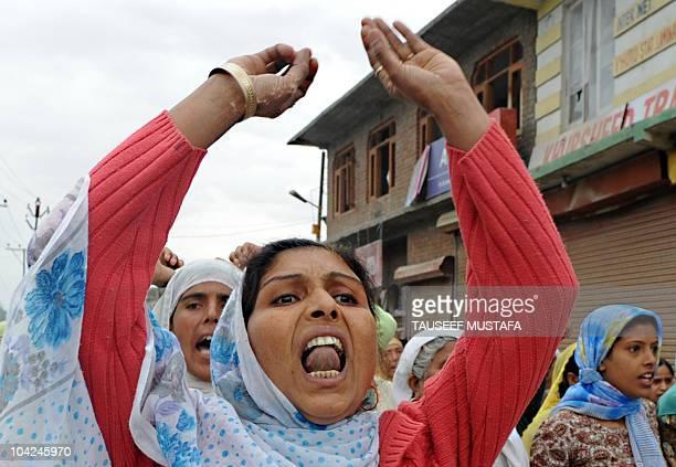 Kashmiri woman shout anti Indian slogans near a body of Fayaz Ahmad during his funeral preparations in Srinagar on September 18 2010 Fayaz was...