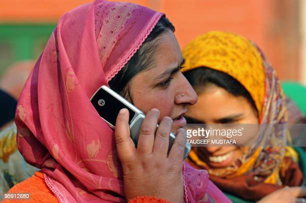 A Kashmiri woman speaks on a cell phone in Srinagar on January 21 2010 India revoked a ban on prepaid mobile telephones in Kashmir after authorities...