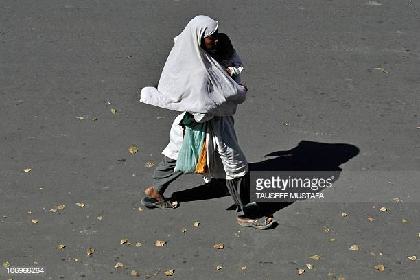 A Kashmiri woman walks during a fivehour curfew break in Srinagar on September 26 2010 The hardline separatist leader who has organised months of...