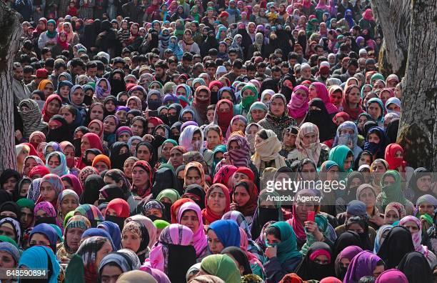 Kashmiri women attend the funeral of top rebel commander Aqib Ahmad Bhat alias Aqib Molvi in south Kashmir's Hyuna village of Tral some 45 kilometers...