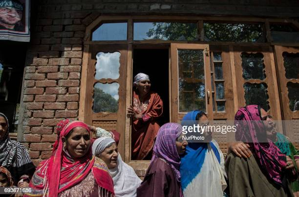 Kashmiri women attend the the funeral of a teenager Adil Magray at Shopian about 60 kilometers south of Srinagar Indianadministered Kashmir Wednesday...