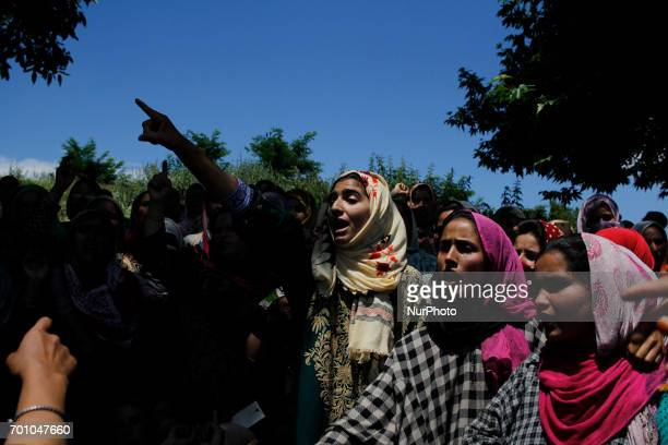 Kashmiri women chant Anti india slogans during the funeral procession of Tauseef AhmedA civilian in Tengpun south of Srinagar Indian Administrated...