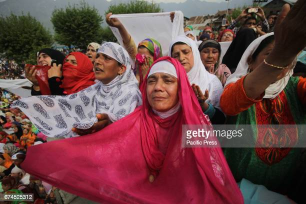 Kashmiri women crying during devotees pray as a head priest displays the holy relic believed to be the hair of the Prophet Mohammed on the occasion...