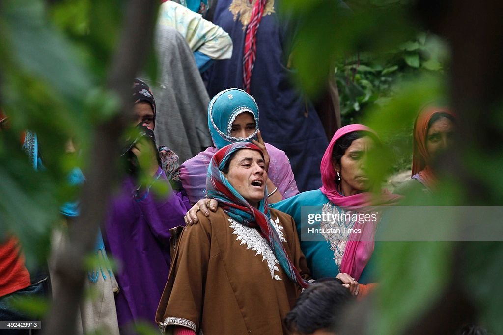 Kashmiri women during the funeral procession of an Army soldier Mushtaq Ahmad Mir at Qazipora Chadoora district, on May 20, 2014 in Srinagar, India. Mushtaq Ahmad Mir, an Army soldier who was killed in an encounter at Chadoora yesterday. An Army soldier was killed and three others injured in an ongoing encounter at Chadoora in district Budgam of central Kashmir. Sources said that militants managed their escape from the spot and forces were now extending the cordon to more areas.