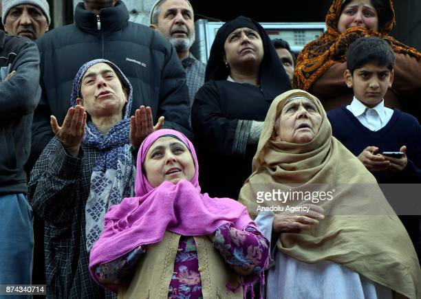 Kashmiri women gesture as they look at the damaged 300 year old mosque of Mir Syed Ali Hamadani after a lightning hit in old Srinagar the summer...