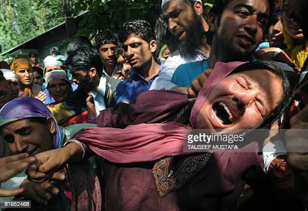 Kashmiri women grieve during the funeral of 65 year old Taja at Tral some 40 kms south of Srinagar on September 28 2009 Three Islamic militants and a...