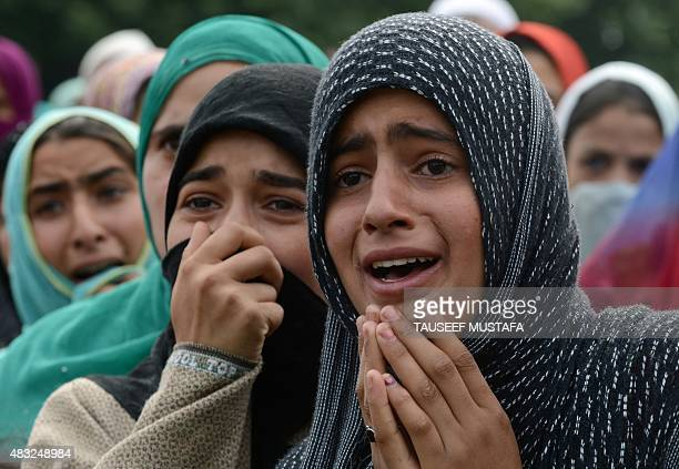 Kashmiri women mourn during a funeral for an alleged LashkereToiba militant in Kakapora south of Srinagar on August 7 2015 One militant was killed in...