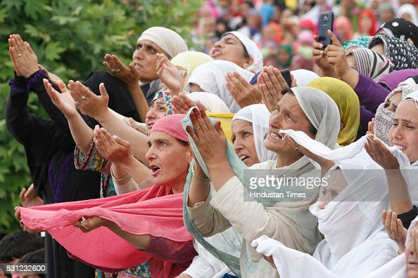 Kashmiri women pray as a head priest displays a holy relic believed to be the hair from the beard of Prophet Mohammed at the Hazratbal Shrine on the...