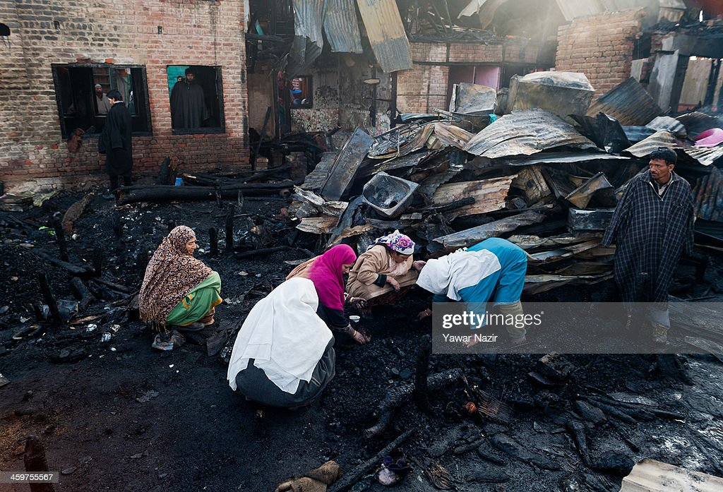 Kashmiri women salvage their belongings after a fire gutted many residential houses on December 30, 2012, in Srinagar, the summer capital of Indian administered Kashmir, India. Many families were left homeless amid sub-zero temperatures during the harshest 40-day period (Chilay Kalan) of the winter, after at least 30 residential houses were damaged in a devastating fire on the bank of famous Dal Lake near the Hazratbal shrine, in the outskirts of the Srinagar. The incident engulfed the area during the preceding night, an official said. No injuries were reported.