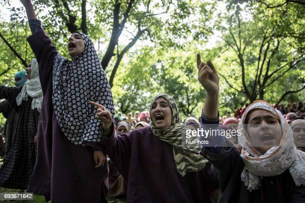 Kashmiri women villagers shout profreedom slogans during the funeral of a teenager Adil Magray at Shopian about 60 kilometers south of Srinagar...