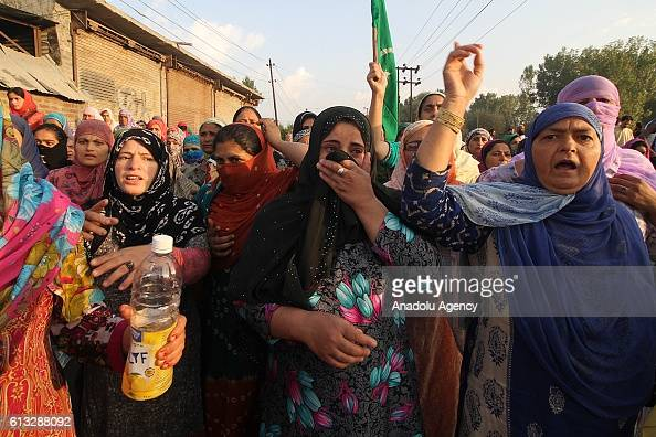 Kashmiri women wail during the funeral of 12 year old boy Junaid Akhoon in Srinagar the summer capital of Indian controlled Kashmir on October 08...