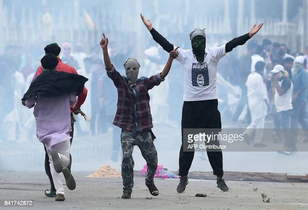Kashmiri youths gesture during clashes between protestors and Indian government forces in Srinagar on September 2 2017 Clashes broke out after Eid...