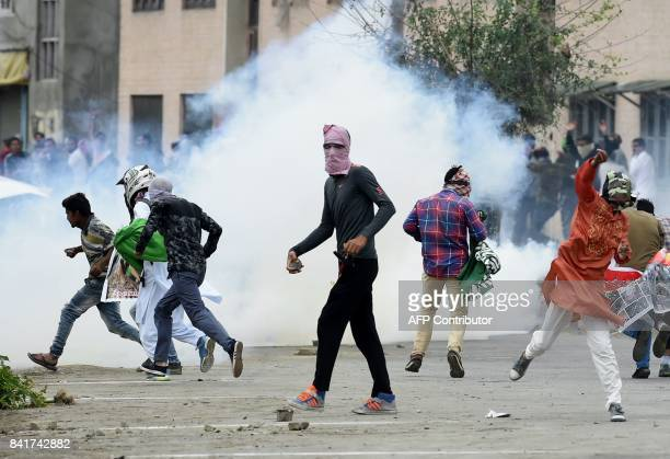 Kashmiri youths throw stones during clashes between protestors and Indian government forces in Srinagar on September 2 2017 Clashes broke out after...