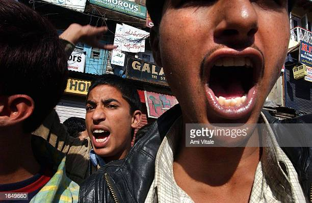 Kashmiri youths yell 'We want freedom' during a protest September 24 2002 in Srinagar the summer capital of the Indian state of Jammu and Kashmir Few...