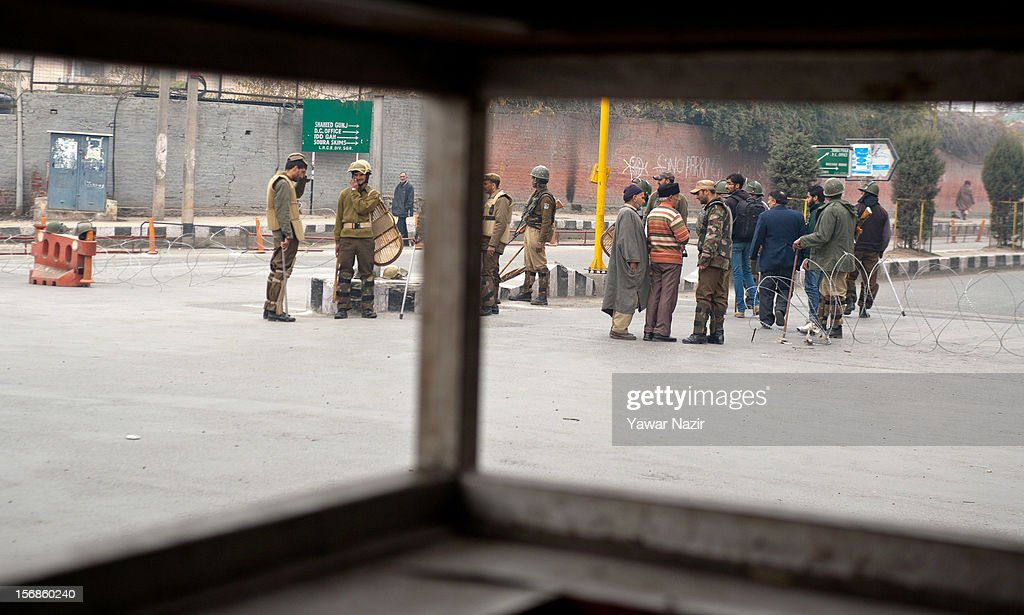 Kashmiris are stopped behind a barricade set up by the Indian police during restrictions on November 23, 2012 in Srinagar, the summer capital of Indian administered Kashmir, India. Hundreds of Shiite Muslim mourners were detained by the Indian police as they tried to take part in the procession. Muslims all over the world mourn during Muharram, the first month of Islamic lunar calendar, the slaying of Imam Hussain, grandson of the Prophet Mohammed who was assassinated by his political rivals along with 72 companions in 680 AD in Iran. Shiite Muslims mourn by flagellating themselves with knives and swords. India has banned any processions and similar public gatherings in Kashmir after a rebellion against Indian rule broke out in 1989.