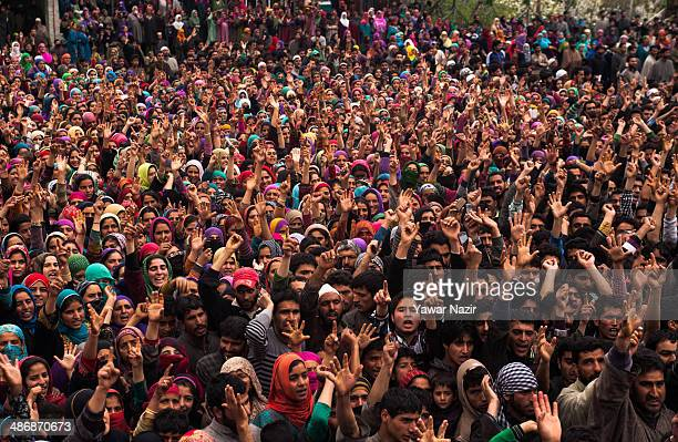 Kashmiris attend the funeral procession of one of three Kashmir militants that were killed in a gun battle with Indian government forceson April 26...