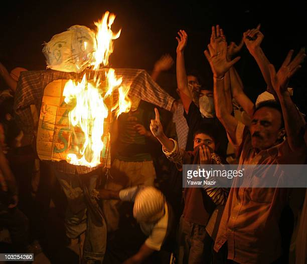 Kashmiris burn the effigy of Kashmir's Chief Minister Omar Abdullah during night demonstrations on August 5 2010 in Srinagar the summer capital of...